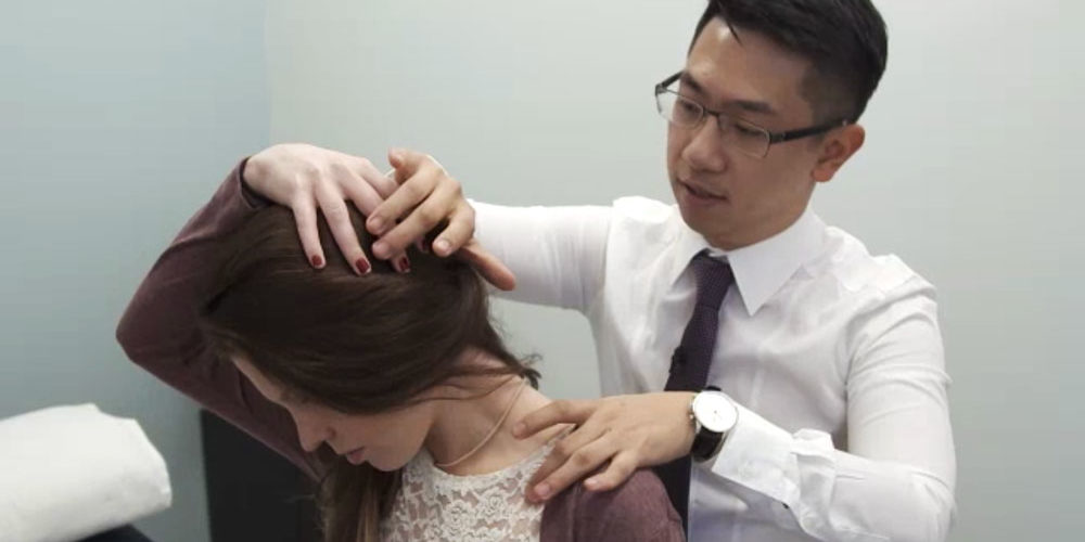 Physiotherapist Justin Lin treating neck pain
